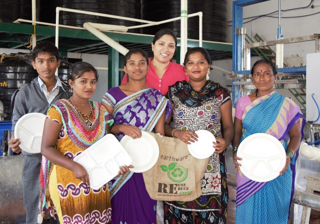 Samanvi standing (behind in the center) with the people she employs